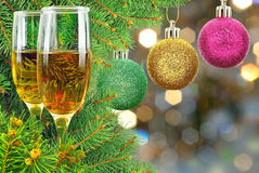 Two glasses of wine under the Christmas tree Stock Photos