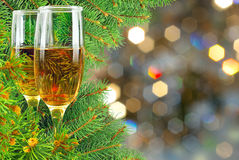 Two glasses of wine under the Christmas tree Royalty Free Stock Image