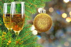 Two glasses of wine under the Christmas tree.  Stock Photos
