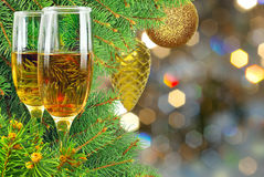 Two glasses of wine under the Christmas tree Stock Images