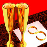 Two glasses with wine and wedding rings stock photography