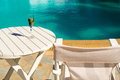 Two glasses with wine on a white table near the pool. Stock Images