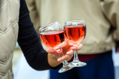 Two glasses of wine in woman hand Royalty Free Stock Image