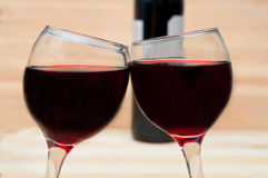 Two glasses of wine on  wooden background Stock Photography