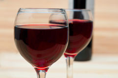 Two glasses of wine on  wooden background Royalty Free Stock Photography