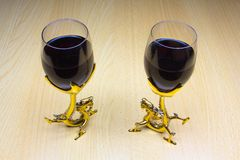 Two glasses of wine on a wooden background royalty free stock photo