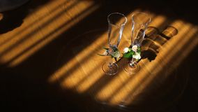 Two glasses on wooden floor stock video