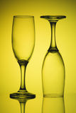 Two glasses in yellow light Royalty Free Stock Images
