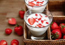 Two Glasses of Yogurt,Red Fresh Strawberries in the Rattan Box on the Wooden Table.Breakfast Organic Tasty Food.Cooking Vitamins I. Ngredients.Summer Fruits Royalty Free Stock Image
