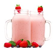 Two glasses of yogurt on white isolated background stock photos