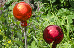 Two glassy garden balls Stock Photography