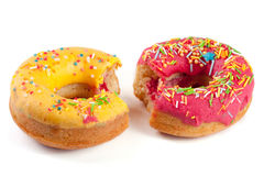Two glazed donut with a bite  on white background Stock Image