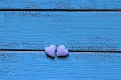 Two glitter hearts on mint background stock photos