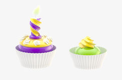 Two glossy cakes isolated. Two glossy bright cakes isolated on grey royalty free stock photo