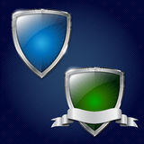 Two glossy security metal shields with place for your text Royalty Free Stock Photography