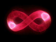 Two glowing hearts in infinity sign Royalty Free Stock Photo