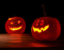 Two glowing jack o lantern pumpkins Royalty Free Stock Images