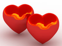 Two glowing red heart with the reflection of fire Stock Images