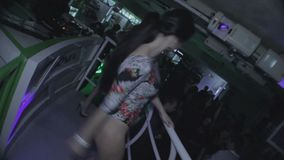 Two go-go girls dancing at nightclub, cheering up public. Stock footage stock video footage