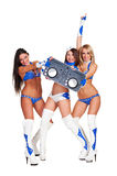 Two go-go dancers and woman dj holding controller Stock Images