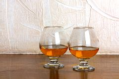 Two goblets of brandy on wooden  counter top Royalty Free Stock Photos