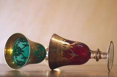 Two goblets. Red and green goblets lying down Royalty Free Stock Image