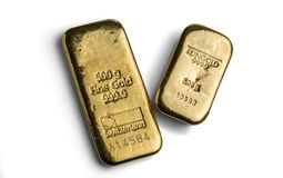 Two gold bars weighing 500 grams each isolated on a white background. Swiss and German gold bars. Feingold is fine gold stock image