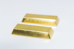 Two gold bars on white background Stock Images