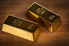 Two gold bars on wooden background. Gold bars - financial concept Stock Image