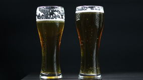 Two gold beer glasses stock video