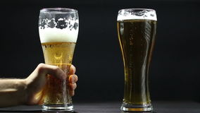 Two gold beer glasses stock video footage