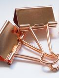 Two Gold Binder Clips Royalty Free Stock Image