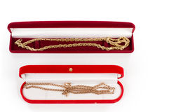 Two gold chains in gift boxes Royalty Free Stock Images
