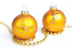 Two gold christmas ball and gold decoration, isola Royalty Free Stock Images