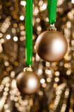 Two gold Christmas baubles Royalty Free Stock Photography