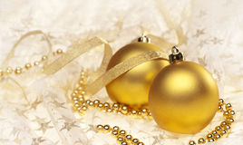 Two gold Christmas baubles Stock Photo