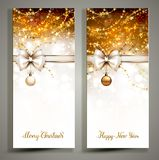 Two gold Christmas greeting cards with bow. Stock Photography