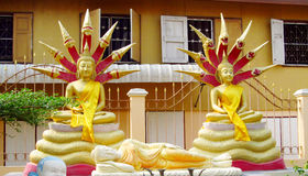 Two Gold-coloured Buddha statue in Buddhist temple Stock Photo