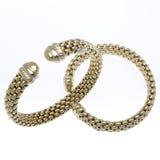 Two Gold Cuff Bracelets. Two 18k Gold Cuff Bracelets Stock Photo