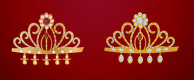 Two gold diadems isolated on red Stock Photos
