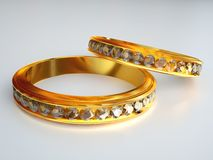 Two gold diamond rings. Committed two gold rings studded with diamonds Stock Images