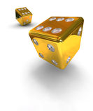 Two gold dice. Two gold falling dice on white background Royalty Free Stock Photo