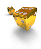 Two gold dice. Two gold falling dice on white background Stock Photography