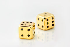 Two gold dice Royalty Free Stock Photo
