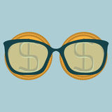 Two gold dollar coins and glasses with diopters. Royalty Free Stock Images