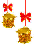 Two gold drums with red bows. On white background Royalty Free Stock Photography