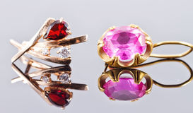 Two gold earrings with rubies and alexandrites Stock Photography