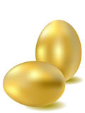 Two gold eggs. On a white background Royalty Free Stock Photo
