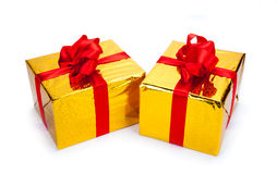Two gold gift boxes. On white background Stock Photography