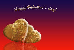 Two gold hearts Stock Photography